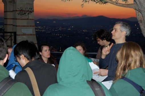 The group learns about Athenian topography as the sun sets over Eleusis.