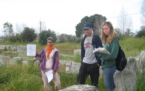 Prof. Faro provides a visual aid while Ben and KT present on a Hellenistic house at Eretria.