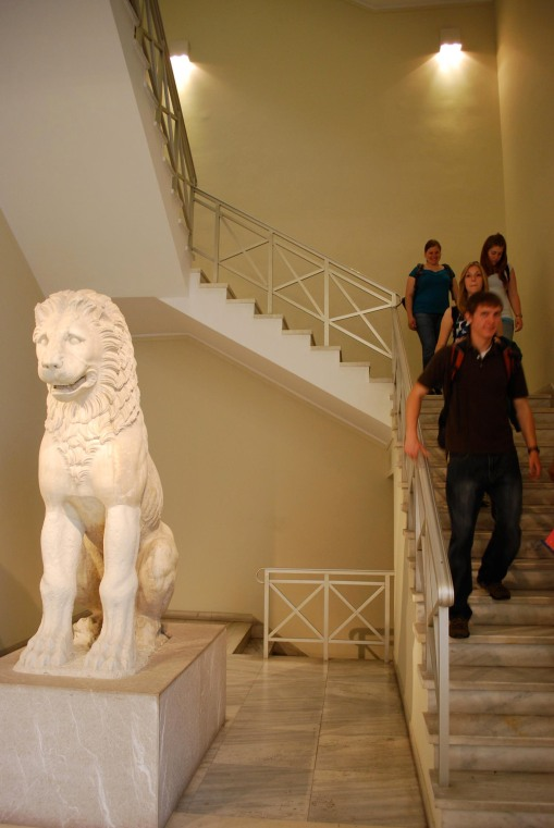 Filing past the Lion of Moschato in the Piraeus museum.