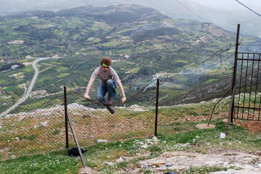 Alex A. leaps the fence at Karphi.