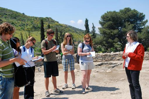 Archaeologist Dimitra Rousioti lectures to the group at Dimini.