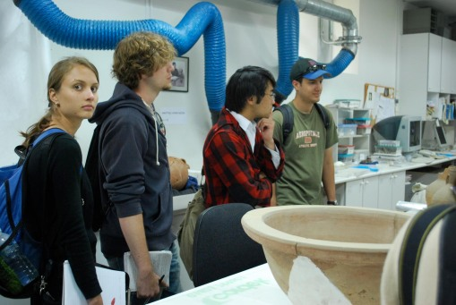 Kathryn, Alex A., Jerry, and Ben inside the conservation lab in the Stoa of Attalos.