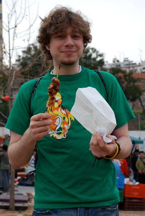 Alex A samples the traditional 9 am flea market souvlaki.