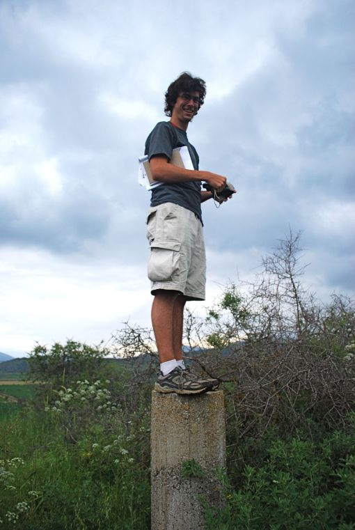 "Jason perches atop a geological marker in order to survey the Mycenaean ""palace"" at Gla."