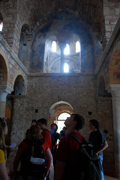 Charlie peers upward at the Byzantine frescoes at Mistras.