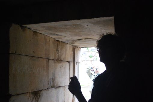 Alex A. cuts a striking profile within the side chamber of the tholos tomb.