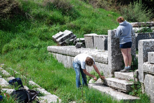 Alex and Kate measure the south doorway of the temple at Lykosoura.