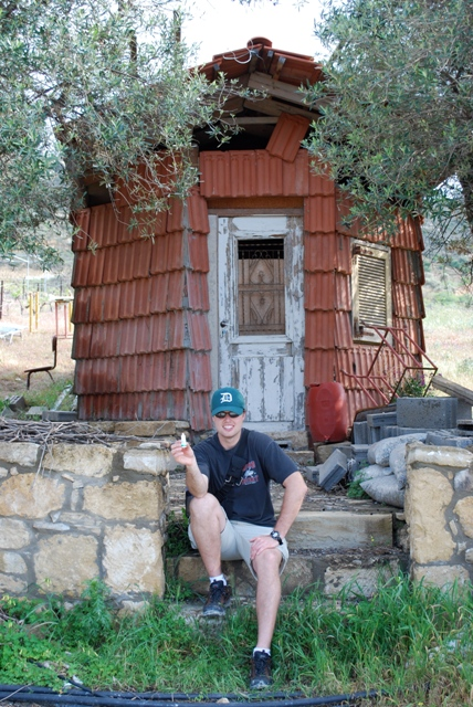 "Joe and his eyedrops pose in front of a modern day ""House of the Tiles"" on the walk back from Kommos."