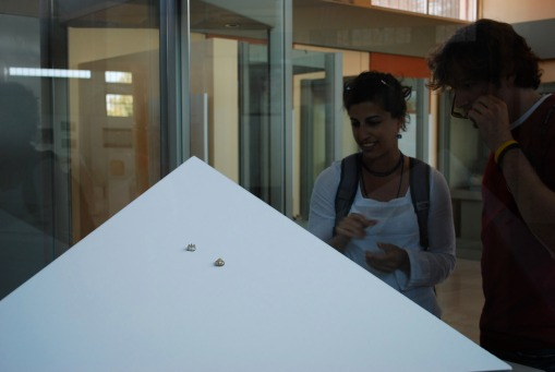 Prof. Faro wows Alex with her explanation of the Aidonia treasure in the Nemea museum.