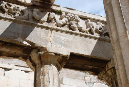 Kaineus gets it at the Hephaisteion.