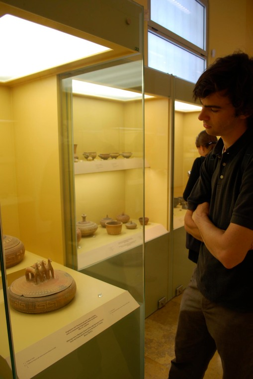 Jason connects with his inner aristocrat via a Geometric horse pyxis at the Agora museum.