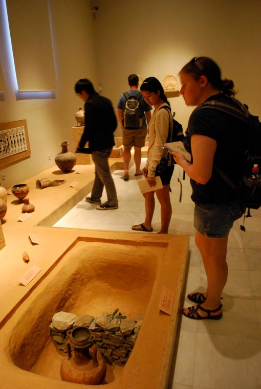 Jerry, Alex M., and Kate check out a display of funerary practices through the ages.
