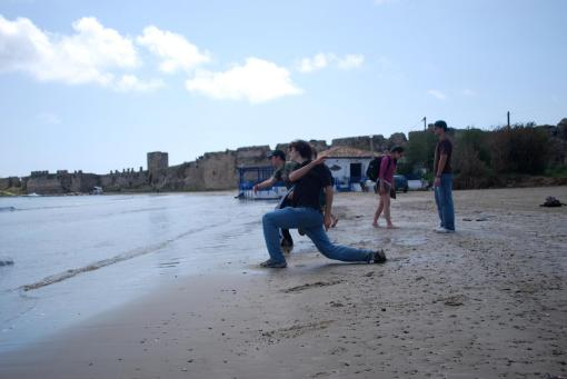 Jason and Ben compete for rock-skipping hegemony.