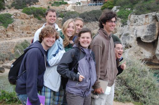 A happy group enjoys the sights and beach at Perachora.