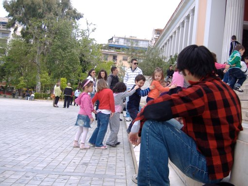 Jerry observes a group of Greek children in the Agora.