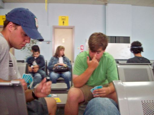 Chris and Charlie studying their cards carefully before the flight.