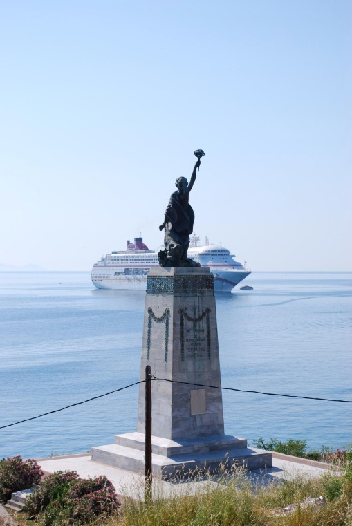 The Lesvian statue of liberty greets a cruise ship coming into the harbor.