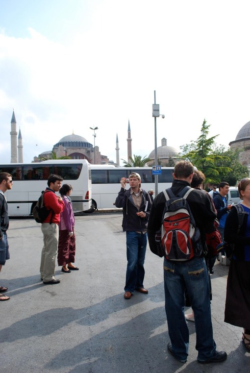 Alex A. makes a memory amongst the tour buses in the square in front of Ayia Sofia.