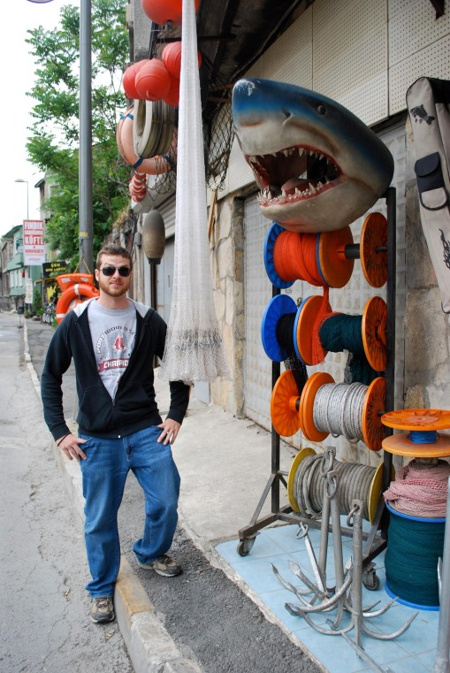 Special FSP guest Chris Young '05 poses with a dramatic fishing tackle display.