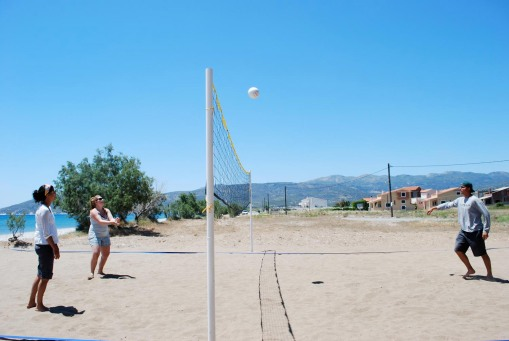 Prof. Faro, Kait, and Chris enjoy a rousing volleyball match at lunchtime.