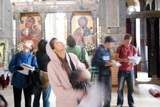 The mosaics of Osios Loukas capture the students' collective gaze in the Katholikon.