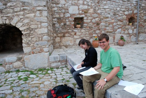 Charlie and Ally work on their assignment in the cloisters outside of the Katholikon.