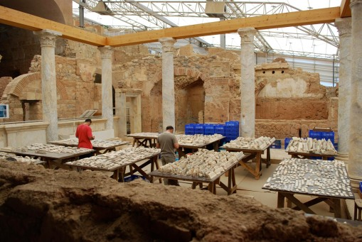 Turkish archaeologists work on reconstructing the huge puzzle of shattered marble revetment from the walls of the terrace houses.