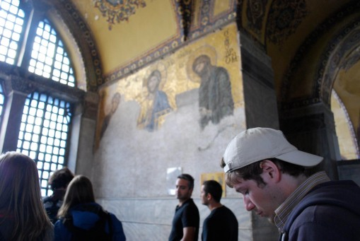 Alex takes notes in front of the impressive mosaics at Ayia Sofia.