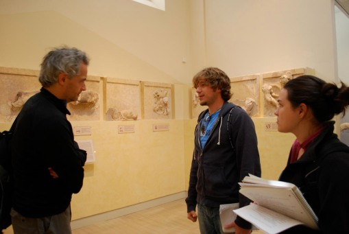 Prof. Christesen gives Dallis and Alex A. some tips as they prep for their afternoon presentation in the museum.