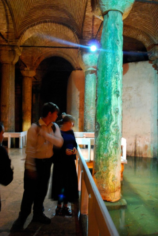 Charlie and Kate examine a strange column in the cistern.