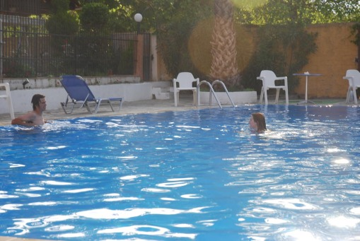 Jason and Kait take some laps in the pool at the hotel on Thasos.