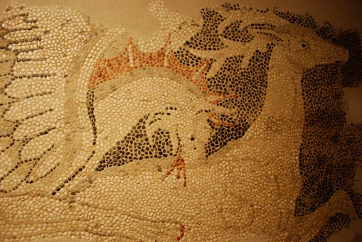 A Griffin pecks a deer in one of the mosaics from Pella.