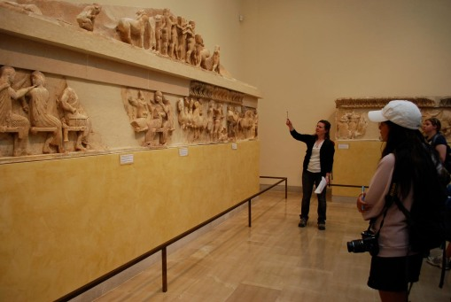 Ally presents the sculpture from the Siphnian treasury.