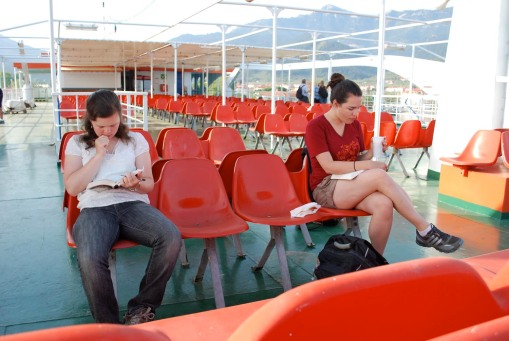 Ally and Dallis read intently on the boat from Thasos to Keramoti.