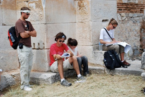 Chris, Jason, Ally, and Kathryn take notes in Basilica B at Philippi.