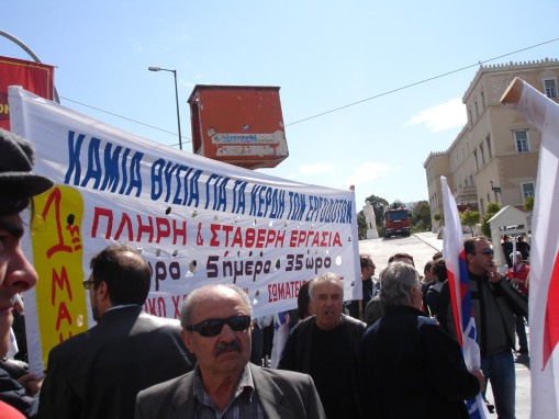 Greek men demonstrate for a 35-hour work week.