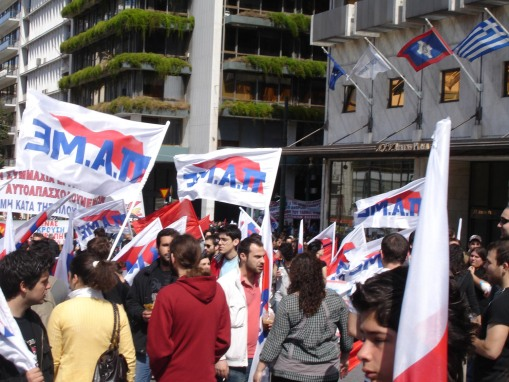 Students carry flags for a Greek socialist party.
