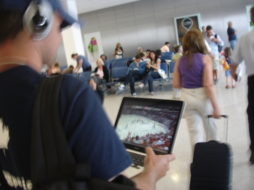 CJ gets his hockey fix in the Athens Airport