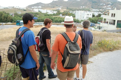 Alex A. in the back studying the landscape as Ben, Joe, Charlie, and PCC look to him for answers.